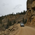 Jeep driving down a dirt road Colorado Jeep Tours