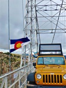 Colorado flag on bridge front of jeep Colorado Jeep Tours