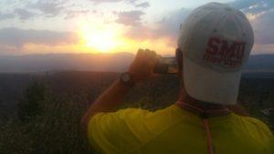 tourist taking photo of sunset at dusk