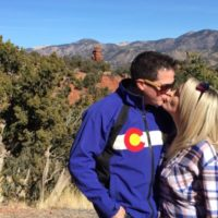 Couple kissing during Red Canyon Colorado Jeep Tour