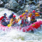 guests getting splashed during Clear Creek whitewater rafting tour