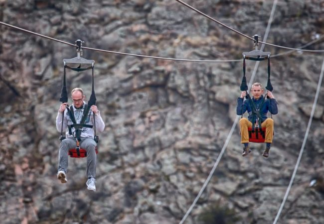 two males experiencing zip line at Royal Gorge Colorado Jeep Tours