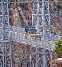 Colorado Jeep Tours riding yellow jeep over Royal Gorge Bridge