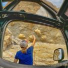 woman tourists touching rock formation Colorado Jeep Tours