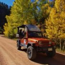 Fall Foliage Colorado Jeep Tour on dirt road with changing leaves in background