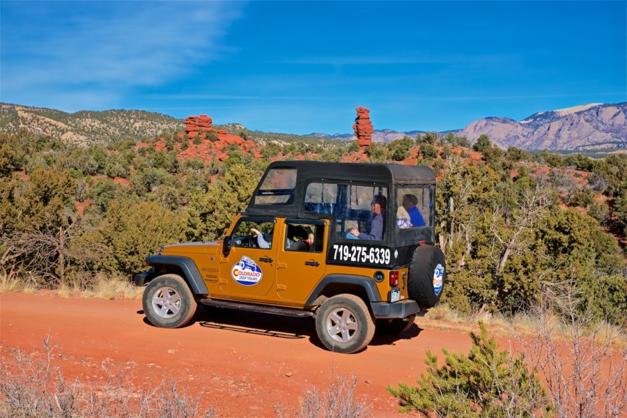Couple Kissing During Red Canyon Colorado Jeep Tour. Previous; Next