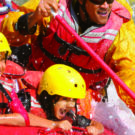 close up of kids getting wet during whitewater rafting tour