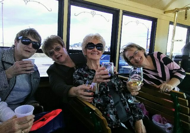 Ladies drinking wine on trolley