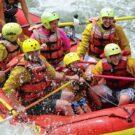 family enjoying whitewater rafting tour