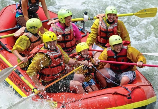 family enjoying whitewater rafting tour