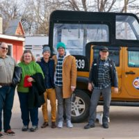 four tourists with guide about to experience a Colorado Jeep Tour