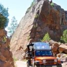 Colorado Jeep tour guide navigating the narrow roads between rock formations