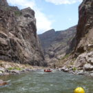 white water rafting with guests going down river