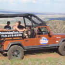 guests in jeep tour overlooking mountain at Fremont Park