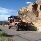 jeep with guests driving down paved road Colorado Jeep Tours