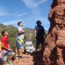 tourists inspecting red rock formations Colorado Jeep Tours