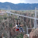 male enjoying zip line over Royal Gorge Colorado Jeep Tours
