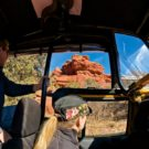 tourists enjoying red canyon formations from inside jeep Colorado Jeep Tours