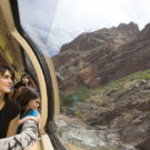 Family looking out Royal Gorge train admiring mountain scenery