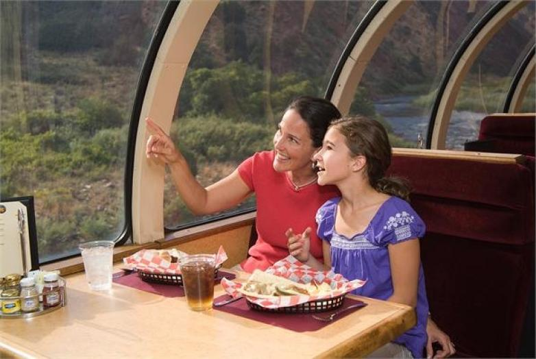Royal Gorge train coming on the tracks Colorado Jeep Tours; mom and daughter looking at scenery from dome car in train Colorado Jeep Tours ...
