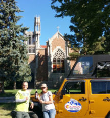 two guests enjoying the wine tour with Jeep and Holy Cross Abbey in background