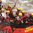 group navigating waves during whitewater rafting trip
