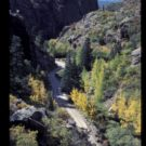 distant image of road between mountain pass Colorado Jeep Tours